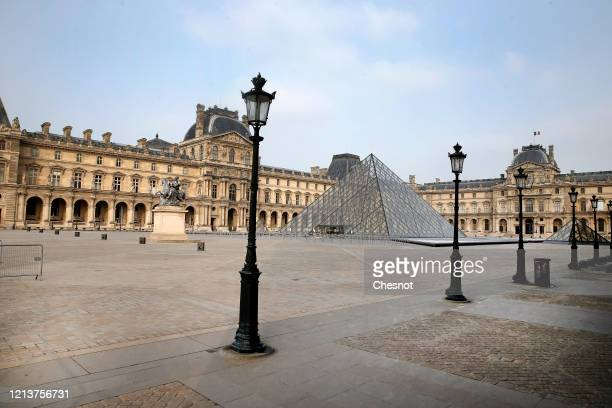 Louvre pyramid and the Louvre museum are seen on the fourth day after the announcement by French President Emmanuel Macron of the confinement of the...