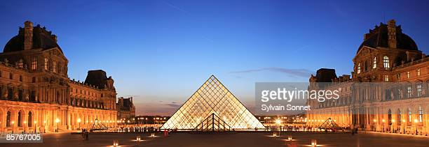 louvre, pyramid framed in arch, paris, france - louvre pyramid stock pictures, royalty-free photos & images