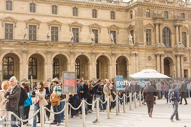 louvre tourists - musee du louvre stock photos and pictures