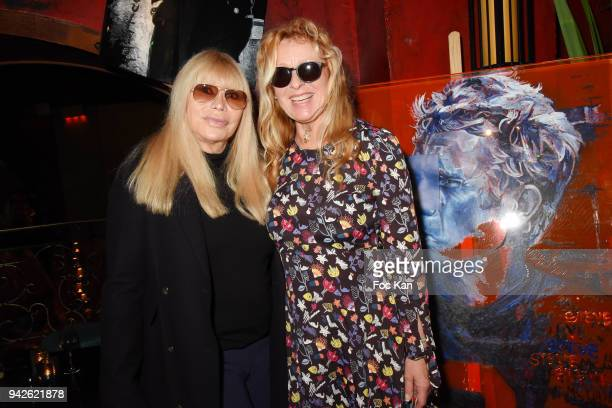 """Lova Moor and painter Natacha Toutain attend """"Steve McQueen Exhibition : 50 years of Bullit"""" by Natacha Toutain at Buddha on April 5, 2018 in Paris,..."""