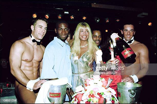 Lova Moor and Yannick surrounded by strip club dancers in Paris, France on March 07th, 2001.