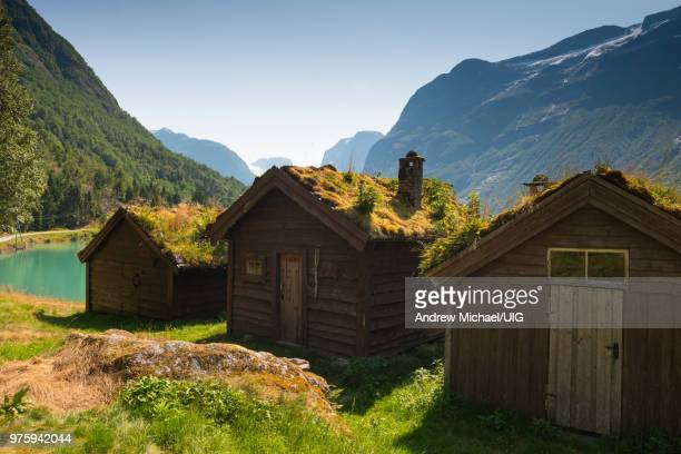 Lovatnet Lake,  traditional Norwegian house topped with sod roof.