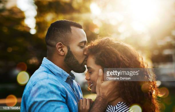love always, kiss a lot - forehead stock pictures, royalty-free photos & images