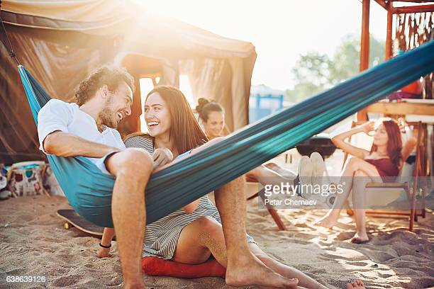 love and friendship in the summer - girls sunbathing stock pictures, royalty-free photos & images