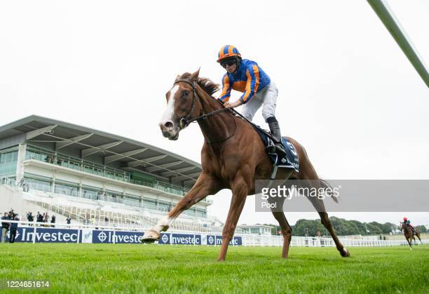 Love and jockey Ryan Moore win the Investec Oaks by 9 lengths at Epsom Racecourse on July 04, 2020 in Epsom, England. The famous race meeting will be...