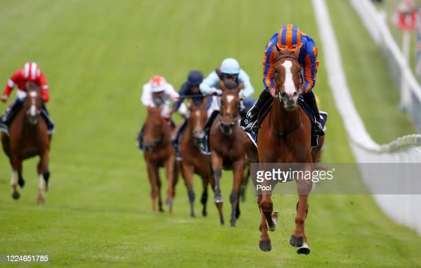Love and Ryan Moore winning The Investec Oaks Stakes at Epsom Racecourse on July 04, 2020 in Epsom, England. The famous race meeting will be held...