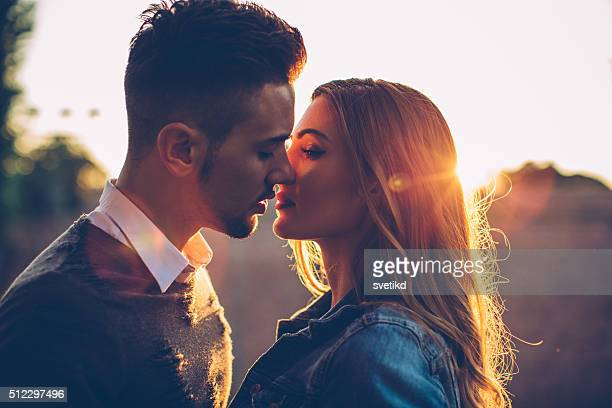 love and sunsets - love emotion stock pictures, royalty-free photos & images