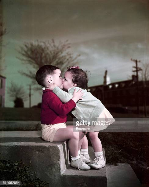 Love as shown by the huge kiss bestowed on 4 year old Larry Kobel by his sister Nancy on the steps of their home in Arlington Va