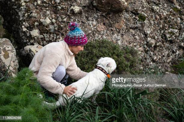 love between a woman and a dog - basak gurbuz derman stock photos and pictures