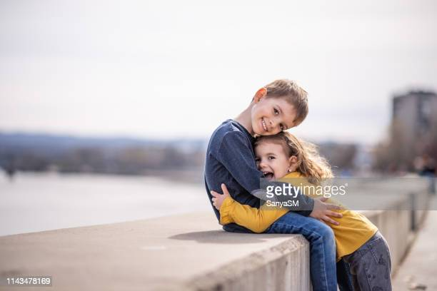 love between brother and sister - brother stock pictures, royalty-free photos & images