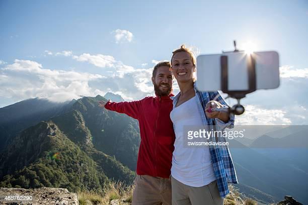 Love birds taking selfie at mountain top