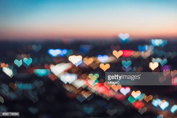 love bokeh of cityscape - heart shape stock pictures, royalty-free photos & images