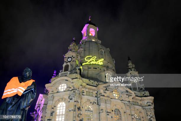 'Love' can be read on the dome of the Frauenkirch church near a concert for cosmopolitanism and tolerance at the Neumarkt in DresdenGermany 26...