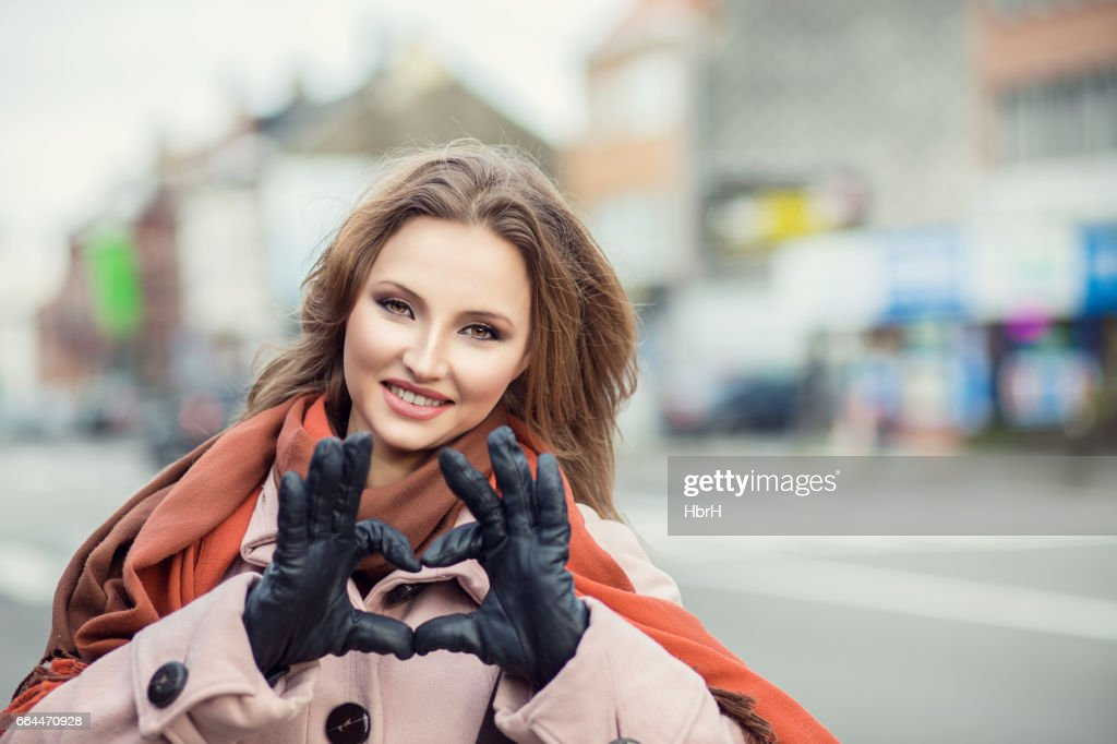 Love Closeup Portrait Smiling Happy Young Woman Making Heart Sign