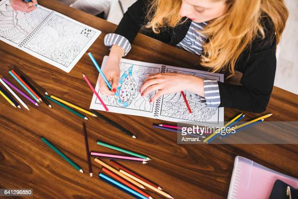 i love colouring during breaks - colouring book stock photos and pictures