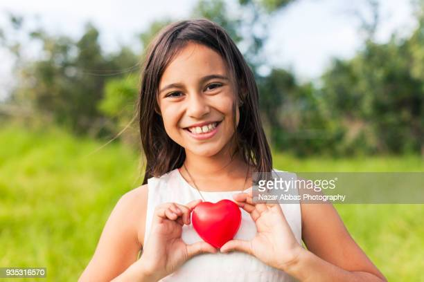 Love Concept : Girl hands holding red heart