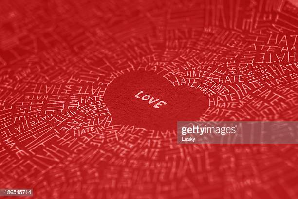 love conquers all - furious stock pictures, royalty-free photos & images