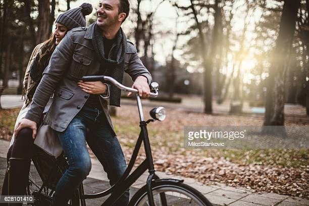 Love Couple with bike outdoors