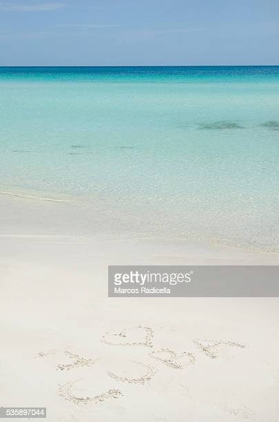i love cuba, written in the beach. - radicella stock pictures, royalty-free photos & images