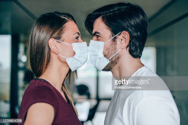 love during quarantine. - kissing stock pictures, royalty-free photos & images