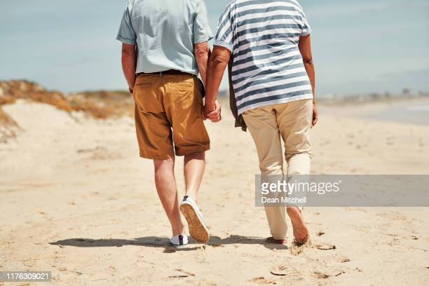 love each other no matter where life takes you - old man feet stock pictures, royalty-free photos & images