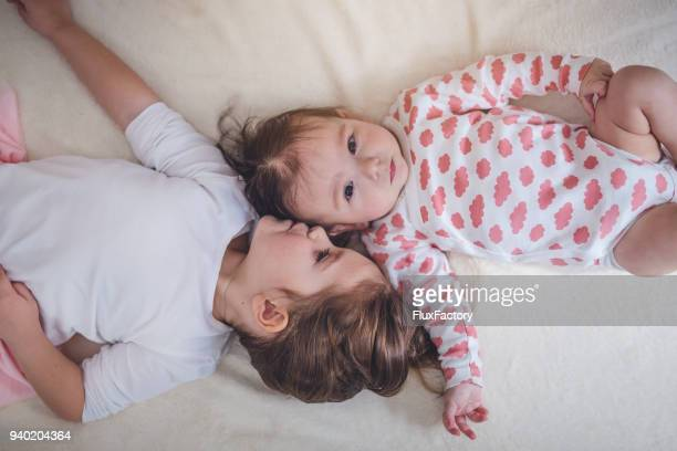 love for a baby sister - sibling stock pictures, royalty-free photos & images