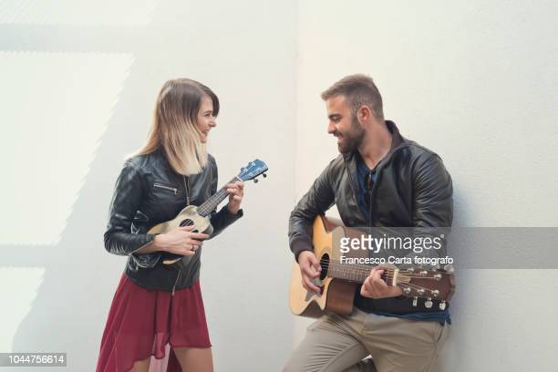 love for the music - ukulele stock pictures, royalty-free photos & images