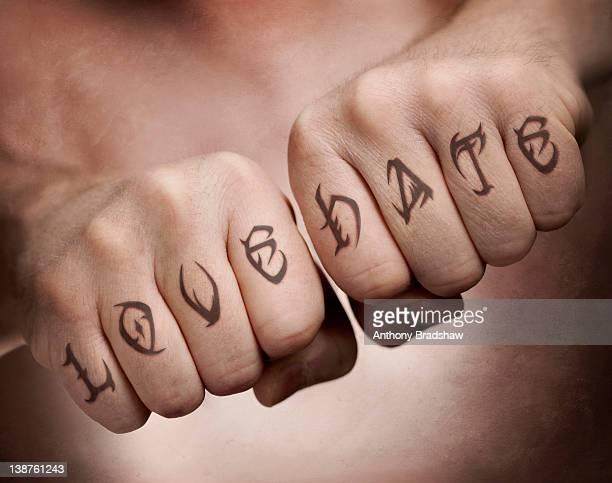 Love, Hate fist tattoos