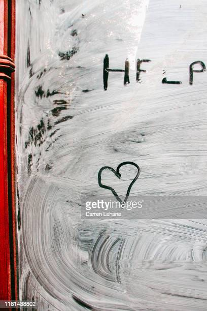love heart & help graffiti - whitewashed stock pictures, royalty-free photos & images