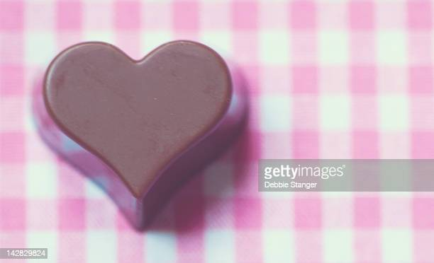 Love heart shaped chocolate on pink gingham