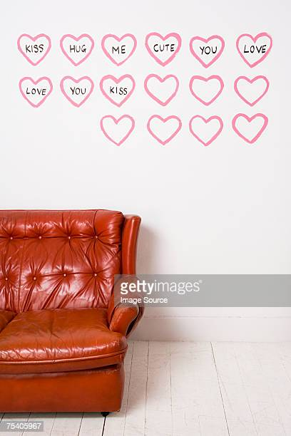 Love hearts and words painted on wall
