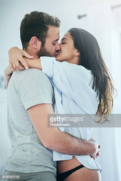 i love holding you - couple cuddling in bed stock photos and pictures