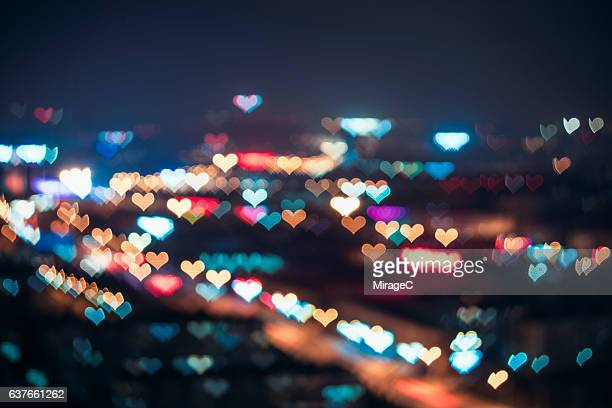 love in city - heart background stock pictures, royalty-free photos & images