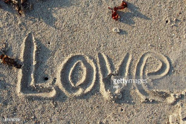 love in sand - word of emotion - pejft stock pictures, royalty-free photos & images