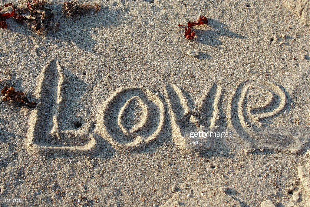 Love in sand - word of emotion : Stock Photo