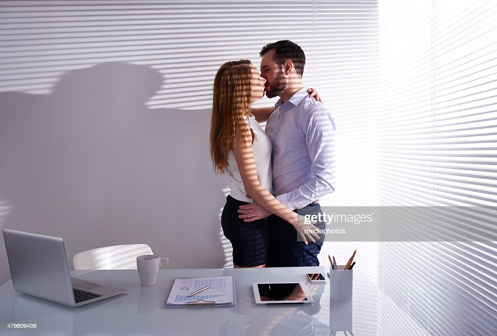 Couple Kissing In Office Stock Photo Getty Images