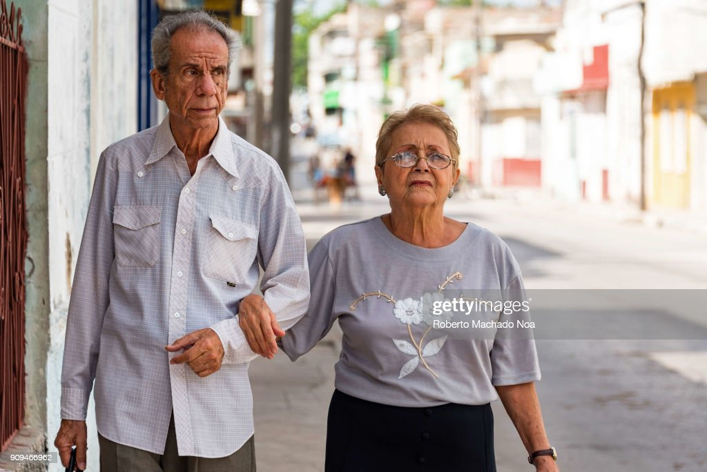 love in the senior years elderly couple walking on the pictures