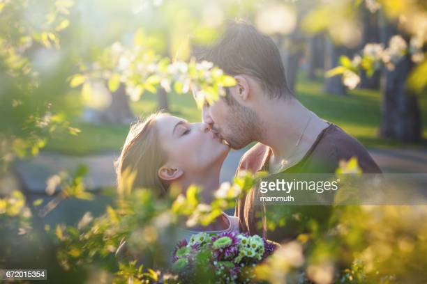 love in the spring - kissing on the mouth stock photos and pictures