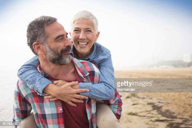 love is always playful - active senior woman stock photos and pictures