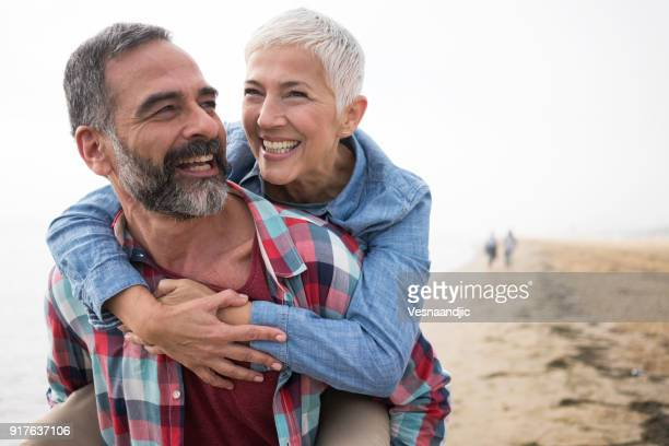 love is always playful - mature couple stock pictures, royalty-free photos & images
