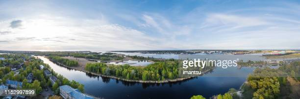 love island in river daugava on a spring evening in riga, latvia - love island stock pictures, royalty-free photos & images