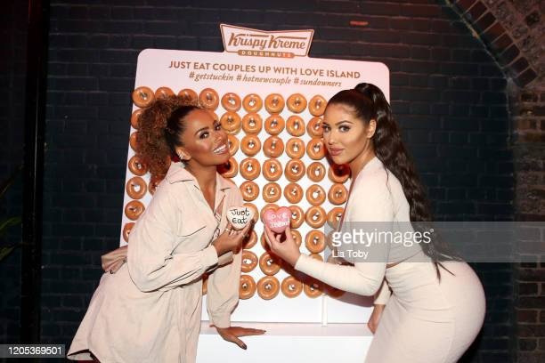 Love Island stars Amber Gill and Anna Vakili attend the Just Eat Ultimate Love Island Date Night event at Night Tales on February 10, 2020 in...