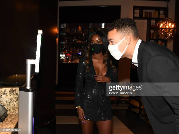"Love Island"" U.S. Season two winners, Justine Ndiba and Caleb Corprew use a temperature reading machine during the reopening of The Cromwell, the..."