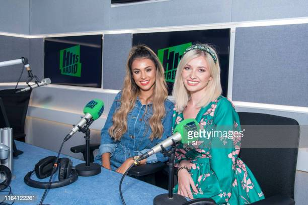 Love Island's Amy Hart and Joanna Chimonides visit the Hits Radio Studio's on July 25, 2019 in London, England.
