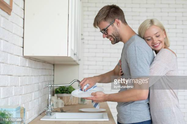 i love it when it's his turn for dishes - wife stock pictures, royalty-free photos & images