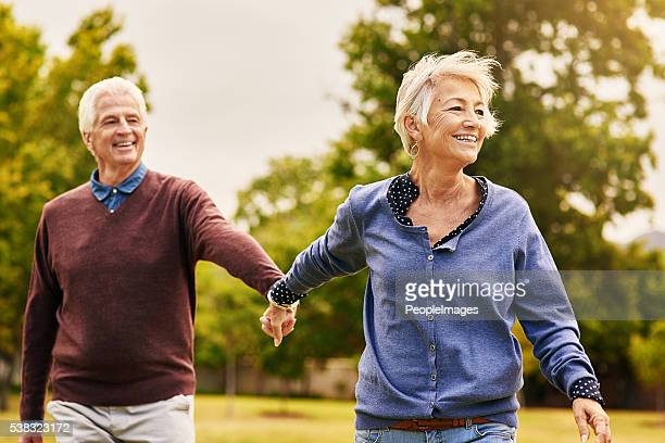 love keeps a marriage alive - active senior woman stock photos and pictures