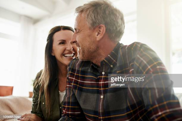 love keeps us happy - mid adult stock pictures, royalty-free photos & images