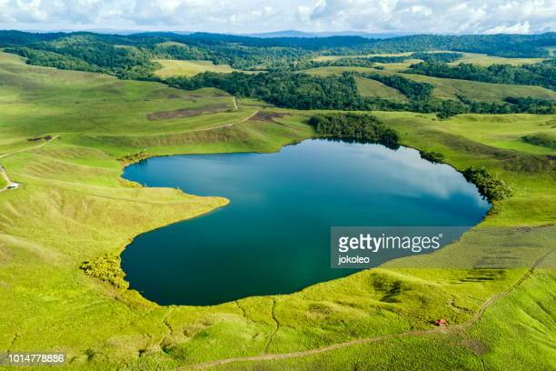 love lake of sentani, jayapura papua indonesia - gulf shores alabama stock pictures, royalty-free photos & images