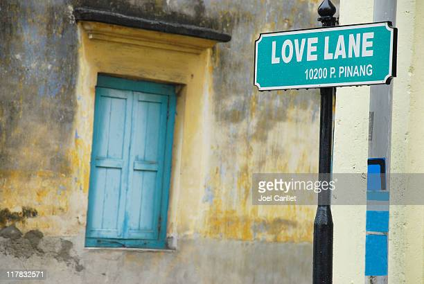 love lane - george town penang stock photos and pictures