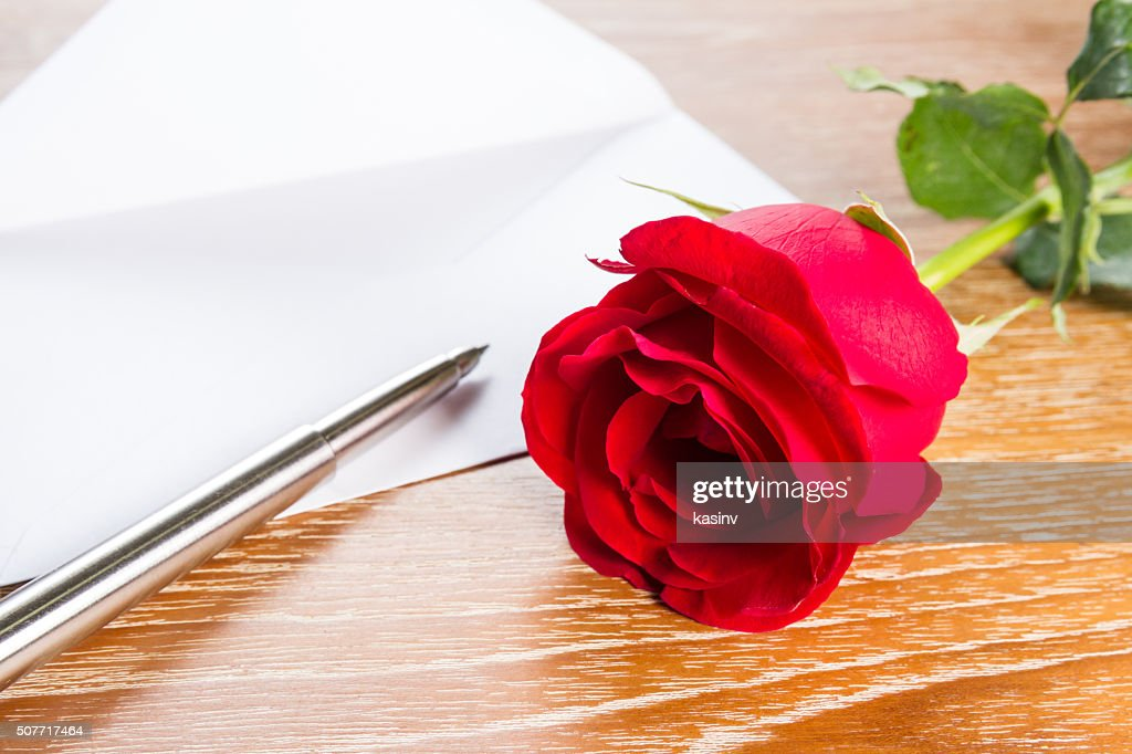 love letter envelope and red rose stock photo